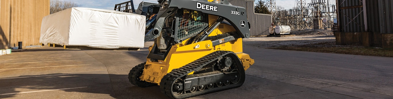 333G CTL with pallet fork attachment on a work site