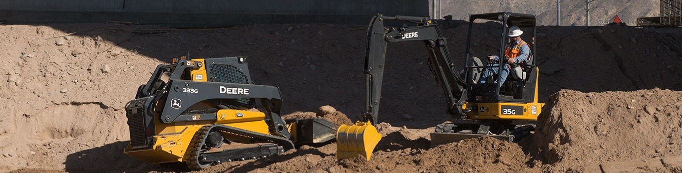 compact equipment with bucket attachments