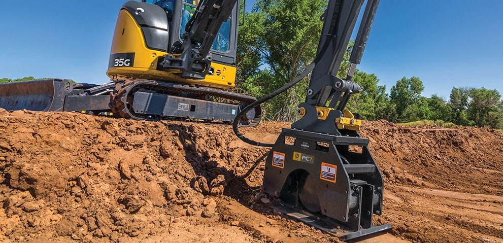 Plate compactor on excavator