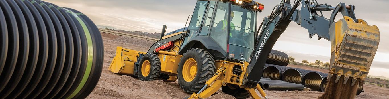 John Deere 310SL HL Backhoe moving dirt on a work site.