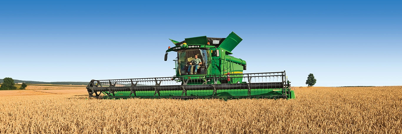 A combine works in a field