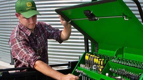 A man opening a John Deere tool chest & Home and Workshop Tools u0026 Equipment   John Deere US