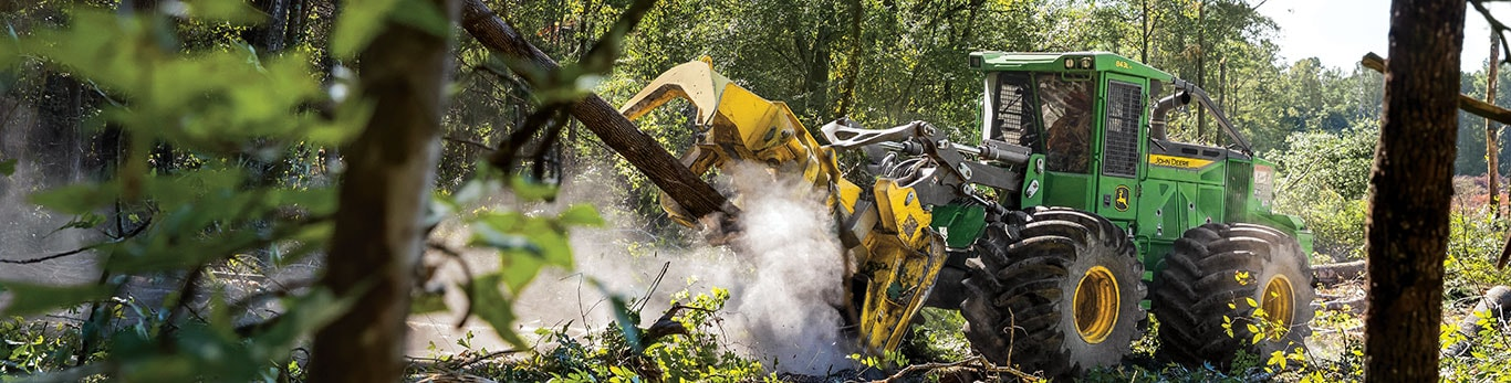 A John Deere 843L-II Wheeled Feller Buncher hard at work in the forest.