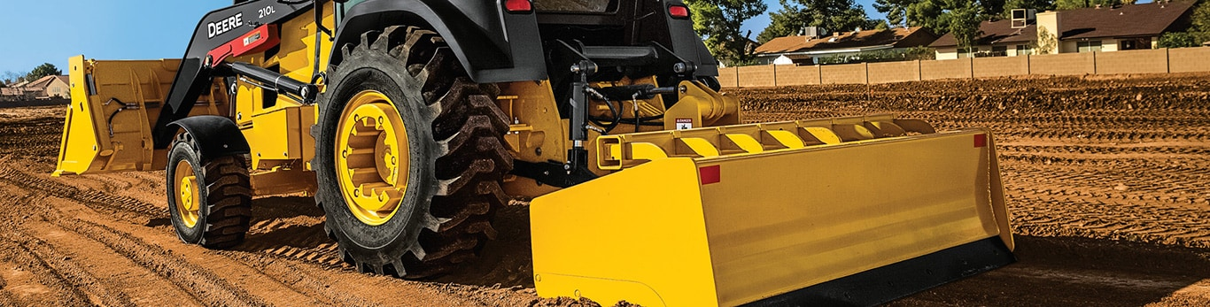 tractor loader reversing at construction site