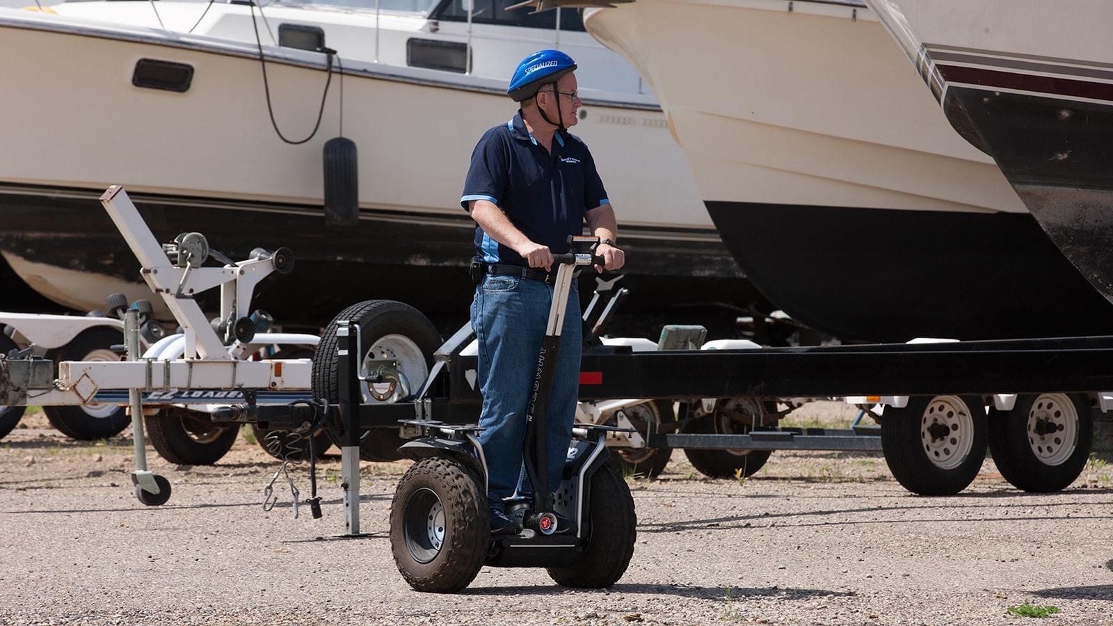 Bill King surveys his boat marina on his Segway.