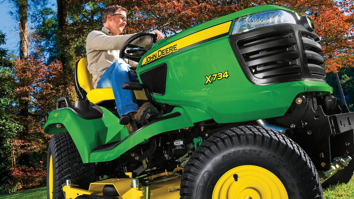 Close up image of man on riding mower