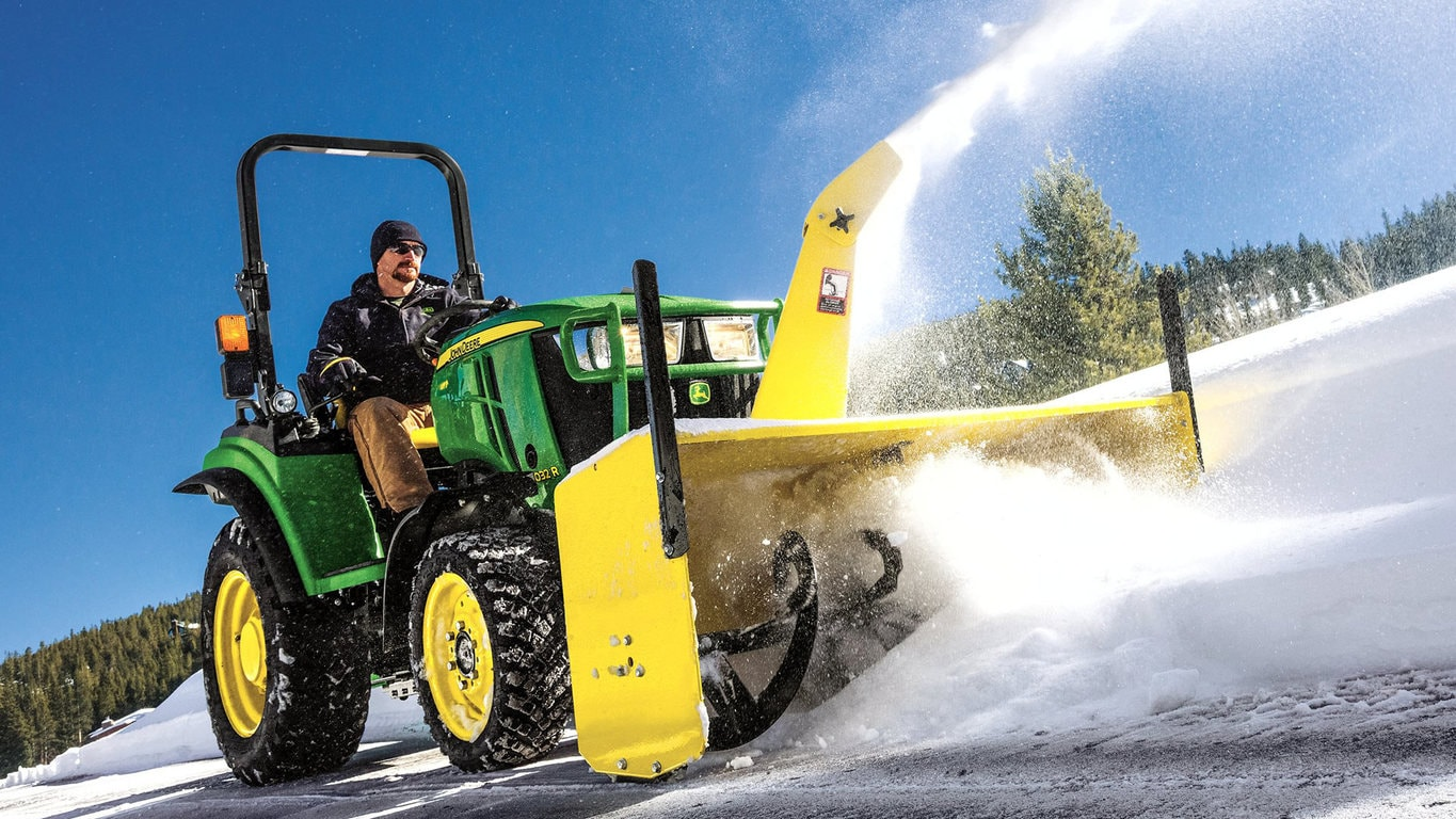 2 series tractor blowing snow off road