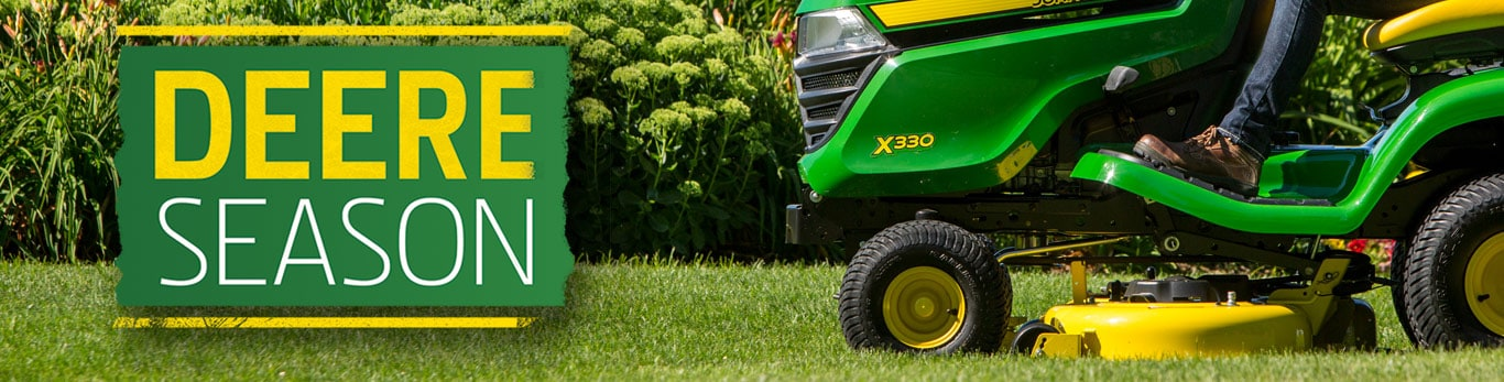 close up image of X330 Riding Lawn Tractor and Deere Season logo