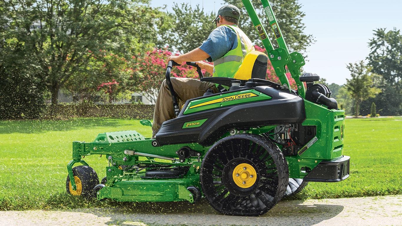 Professional landscaper on John Deere riding mower