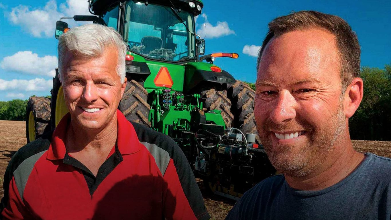 Two Guys in front of a tractor
