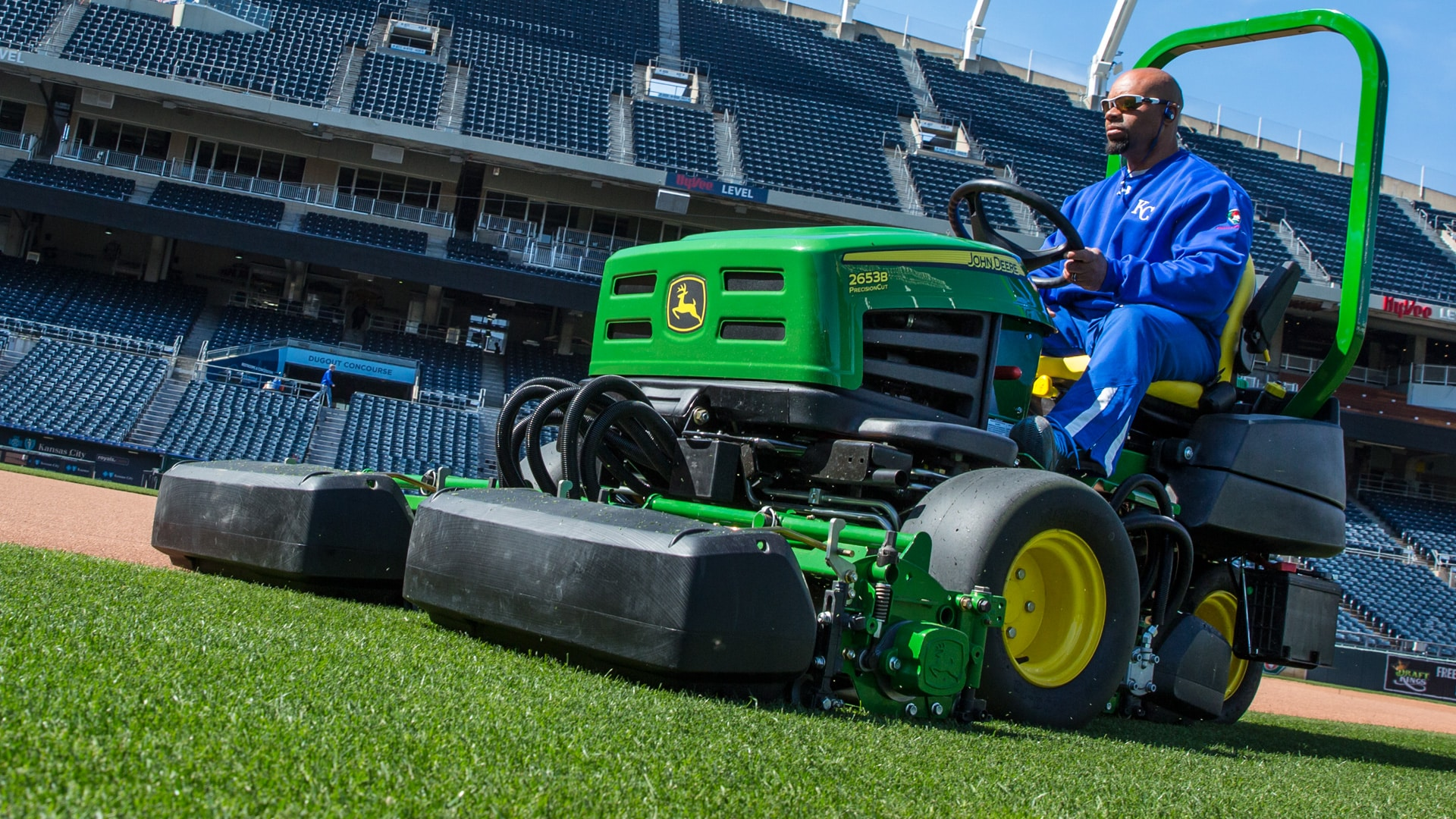 Man cutting grass in a stadium using the 2653B PrecisionCut™ Trim and Surrounds Mower.