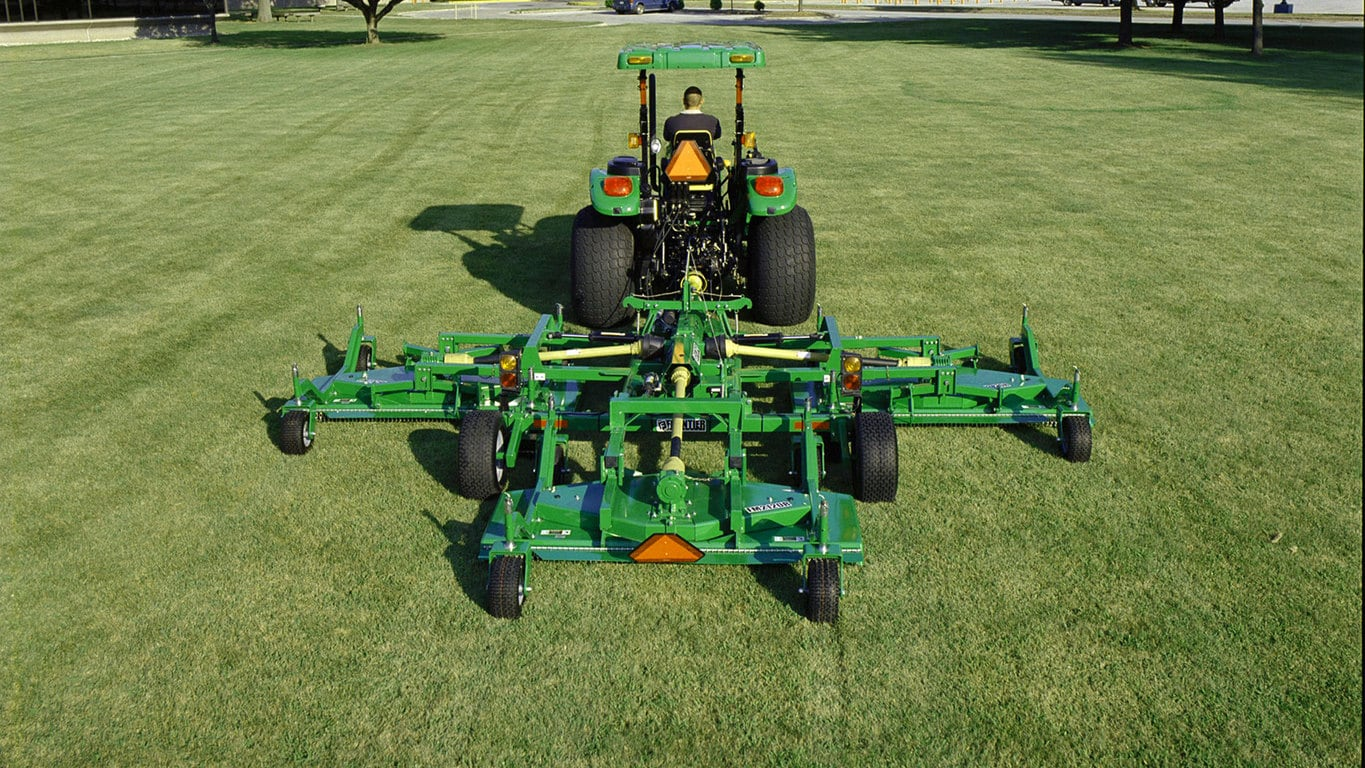 field image of Frontier™ FM21 flex-wing grooming mower attached to a tractor