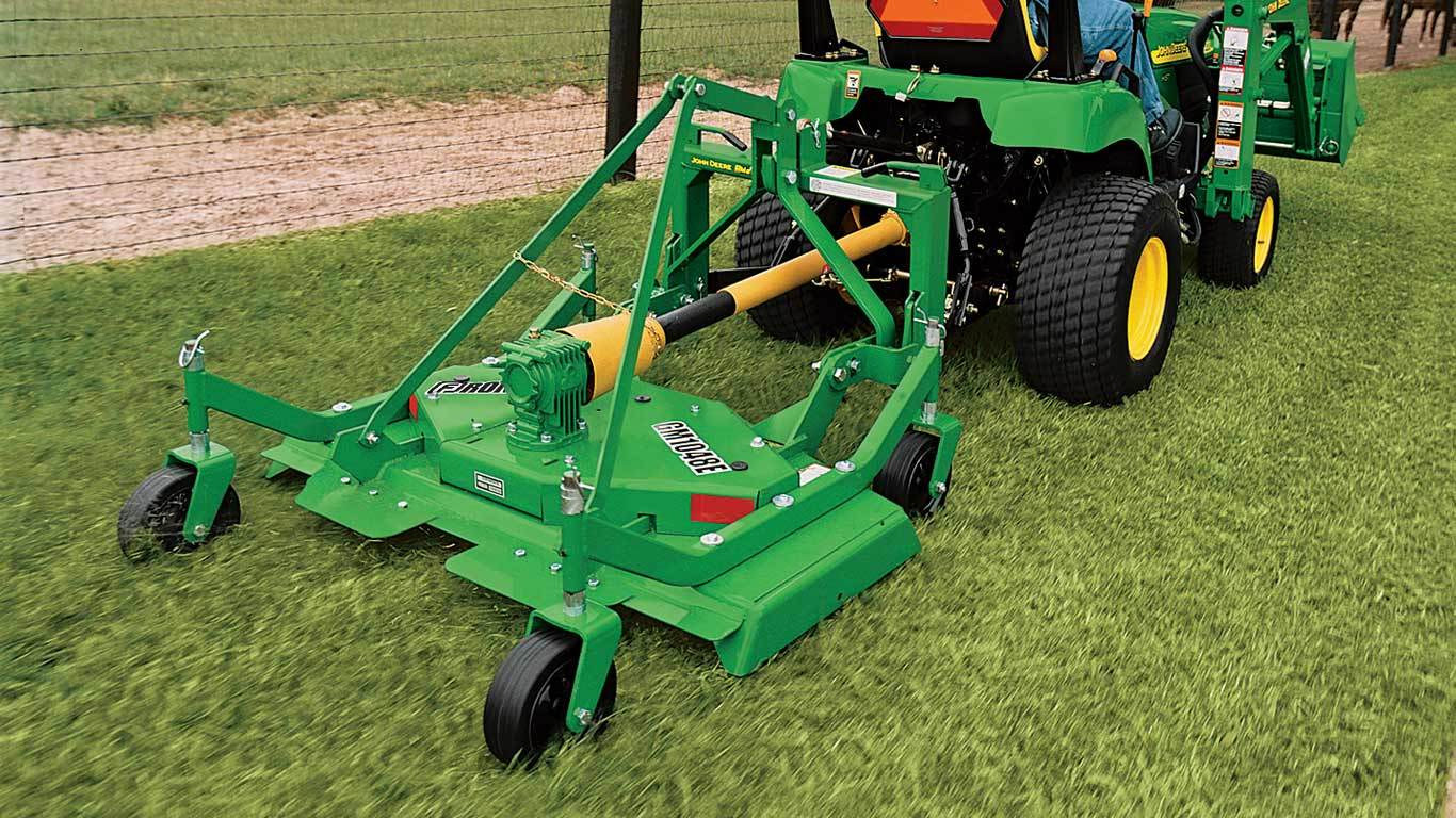 image of GM10 series grooming mower on tractor in field