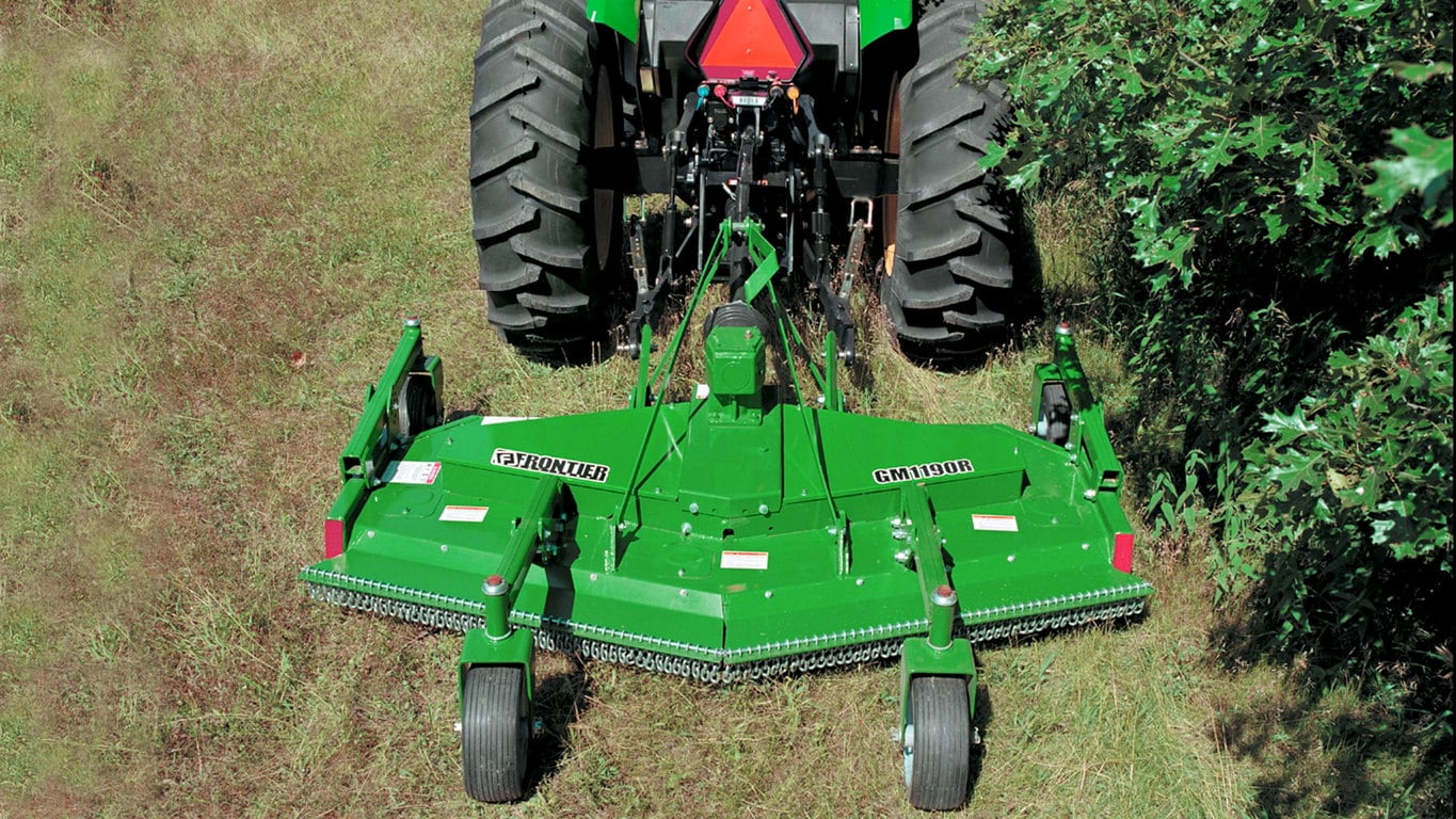 field image of Frontier™ GM11 grooming mower attached to a tractor