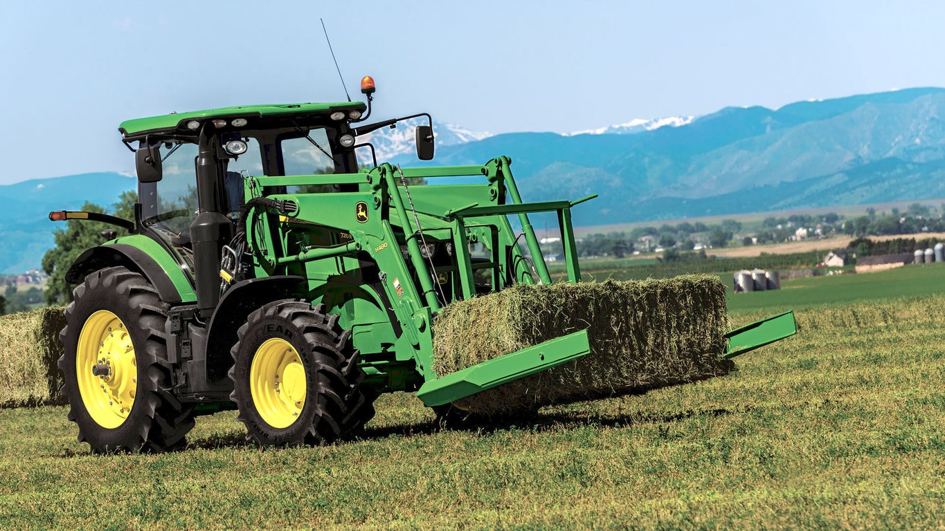 field image of Frontier™ AB17K Large square bale squeeze attached to a tractor