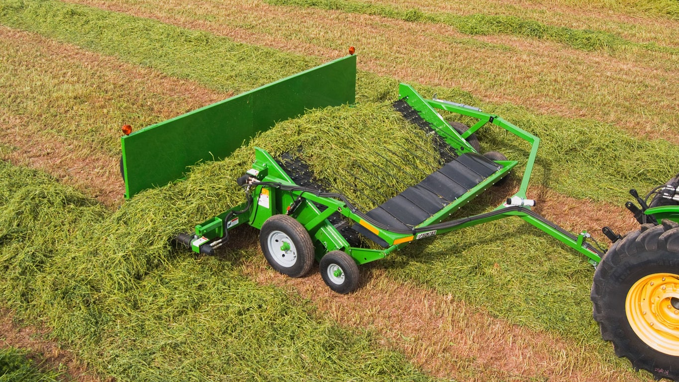 field image of Frontier™ HM11 hay merger attached to a tractor