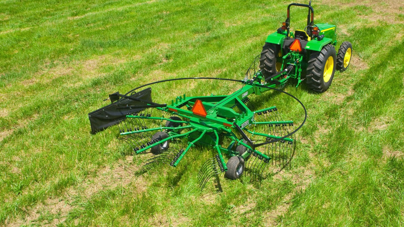 field image of Frontier™ rr23 rotary rake attached to a tractor