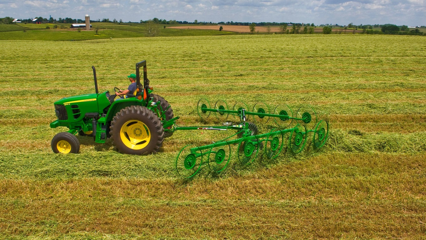 field image of Frontier™ wr30 wheel rake attached to a tractor