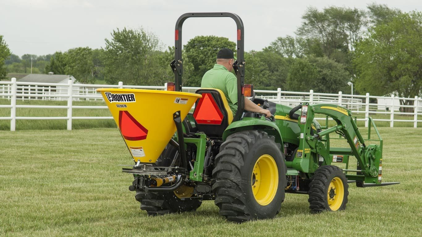 image of Frontier sb20b broadcast spreader on tractor in field