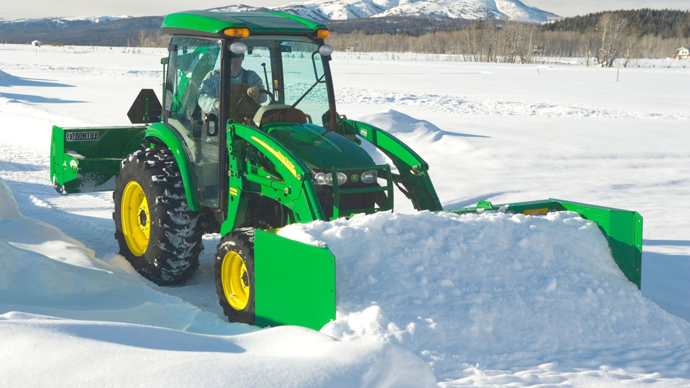 field image of as11e series snow push on a tractor in the snow