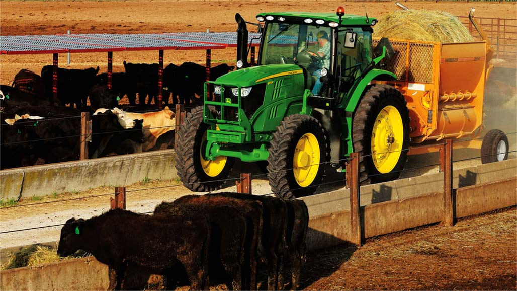Image of tractor and cows