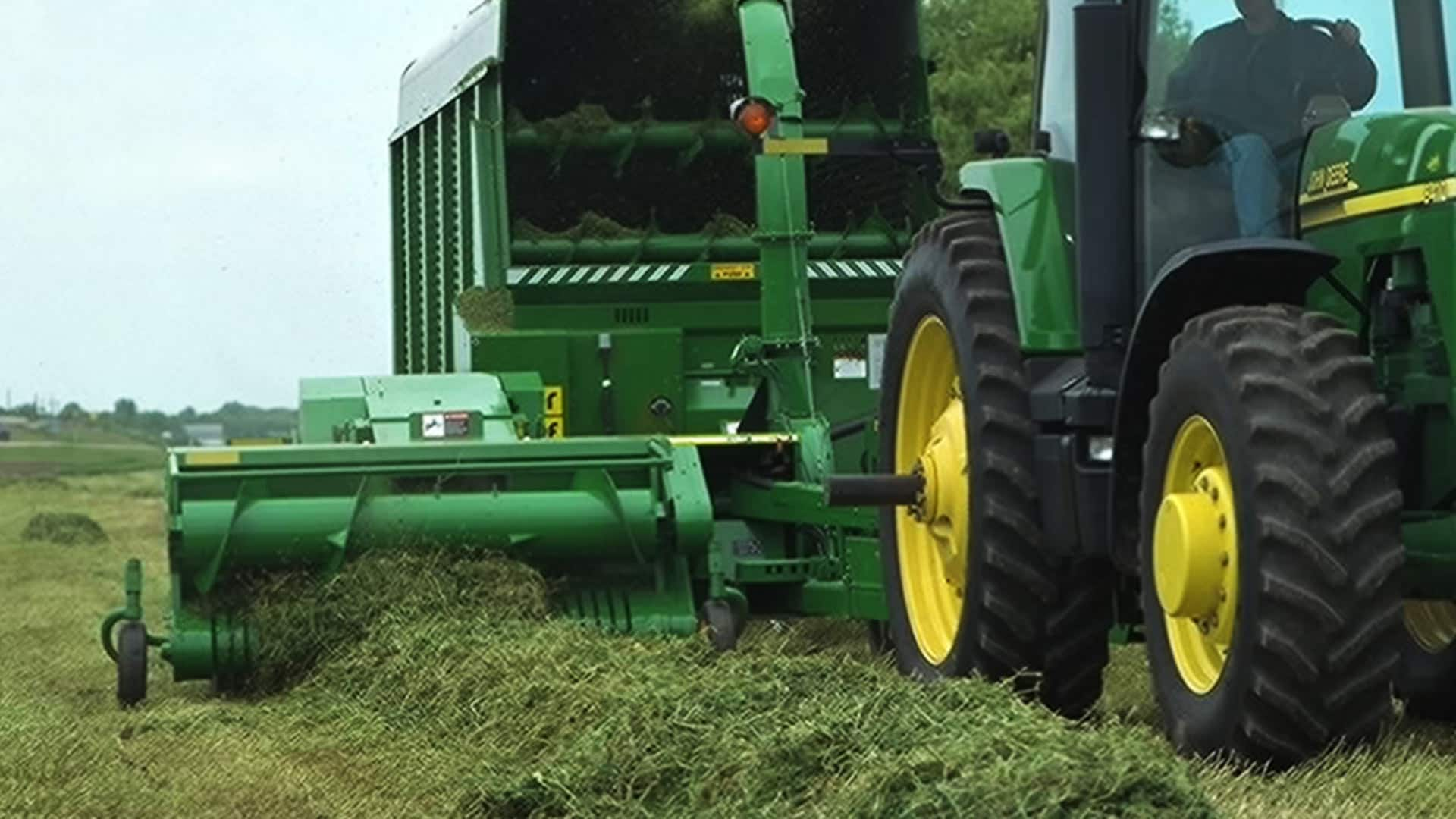 8410 Pull-type forage harvester moving through field