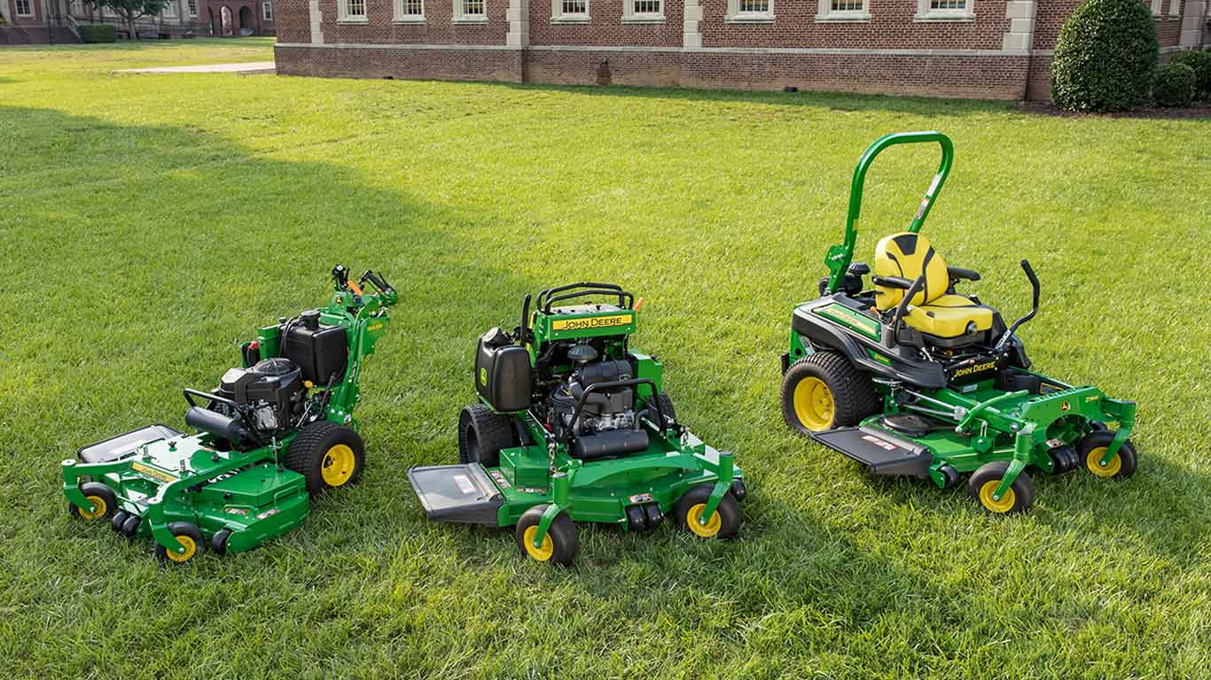 Commercial mowing equipment grouped on property