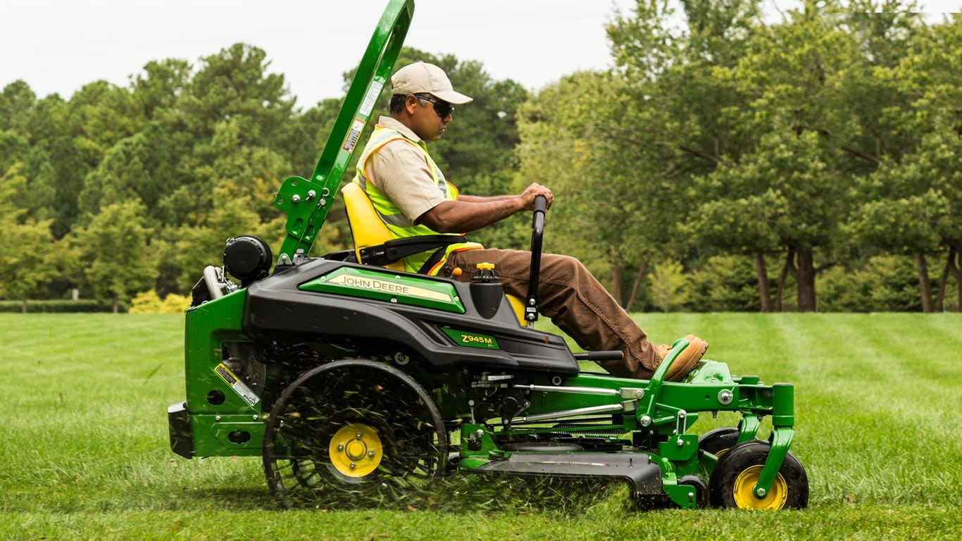 Image of ZTrak Z900 mower with Tweel going over a curb