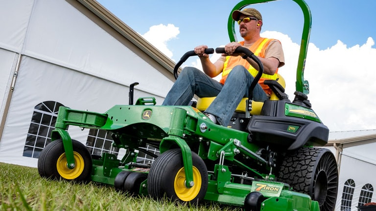 Man on Z955M Commercial Ztrak Mower with Tweel