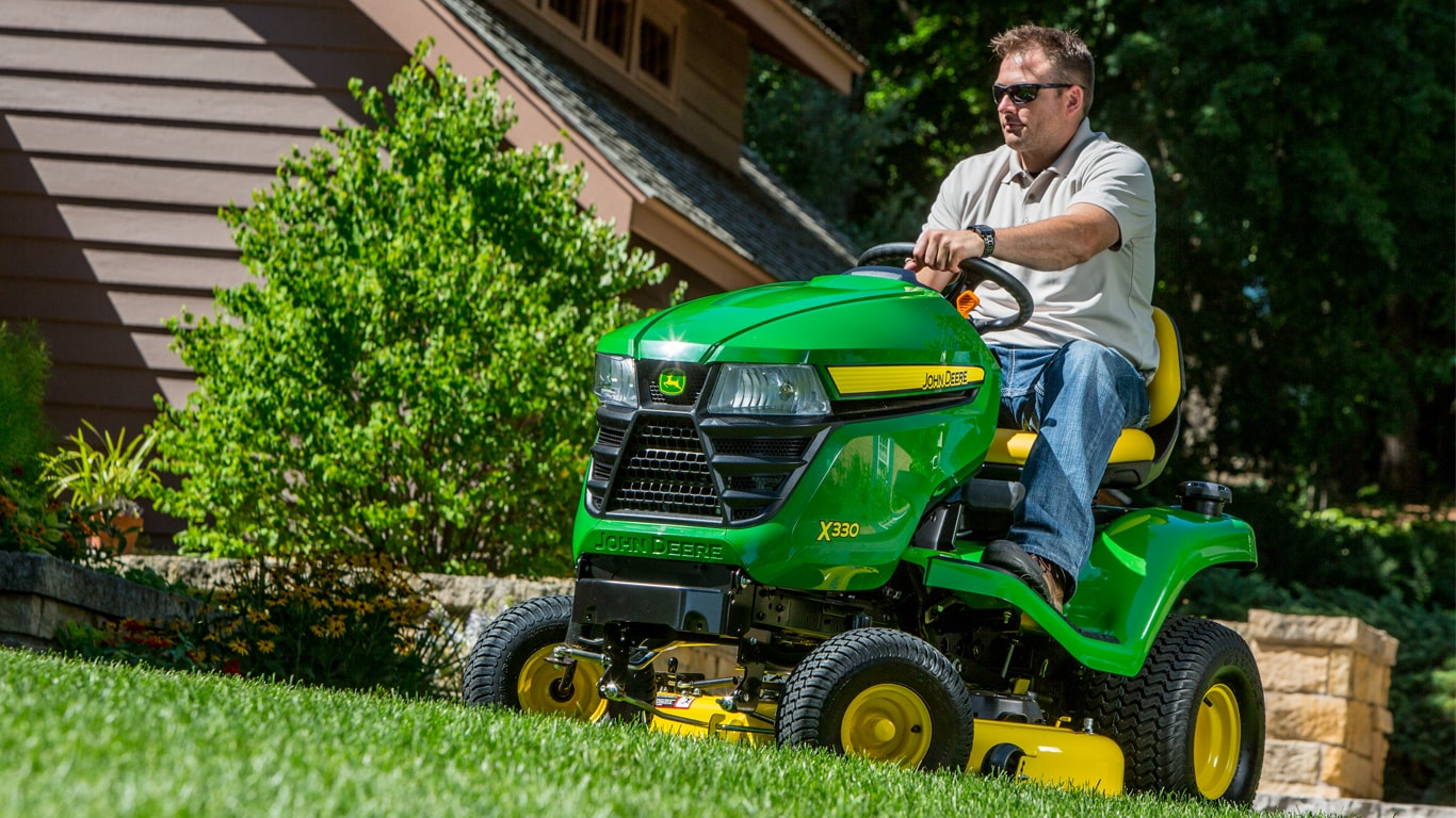 homeowner on tractor in lawn