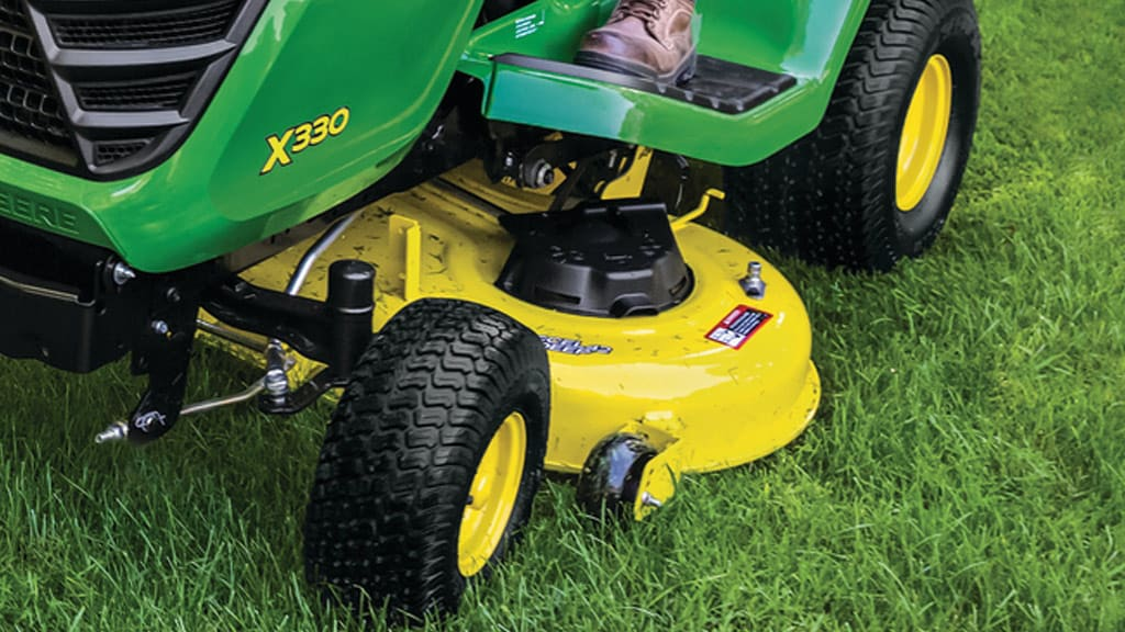 image of mower with an Accel Deep mower deck around flower bed