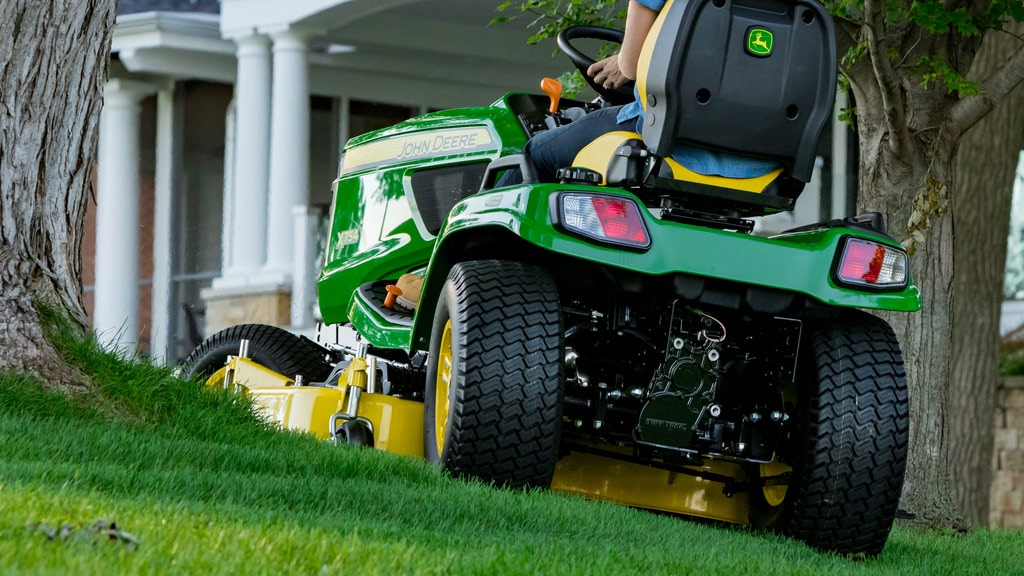 image of mower cutting around a tree