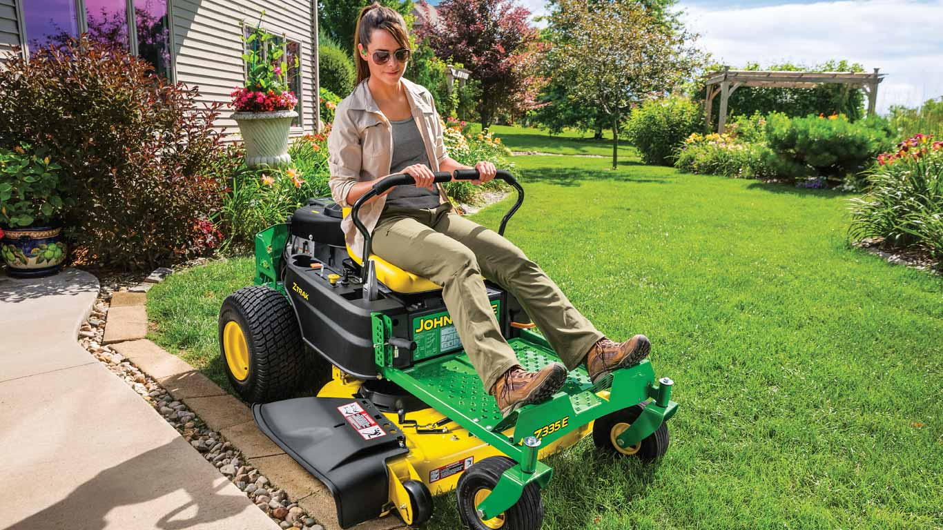 field image of women on a Z300-Series ztrak mower