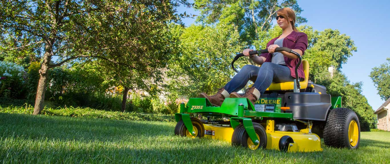low angle view of a woman on a z300 series ztrak zero turn mower