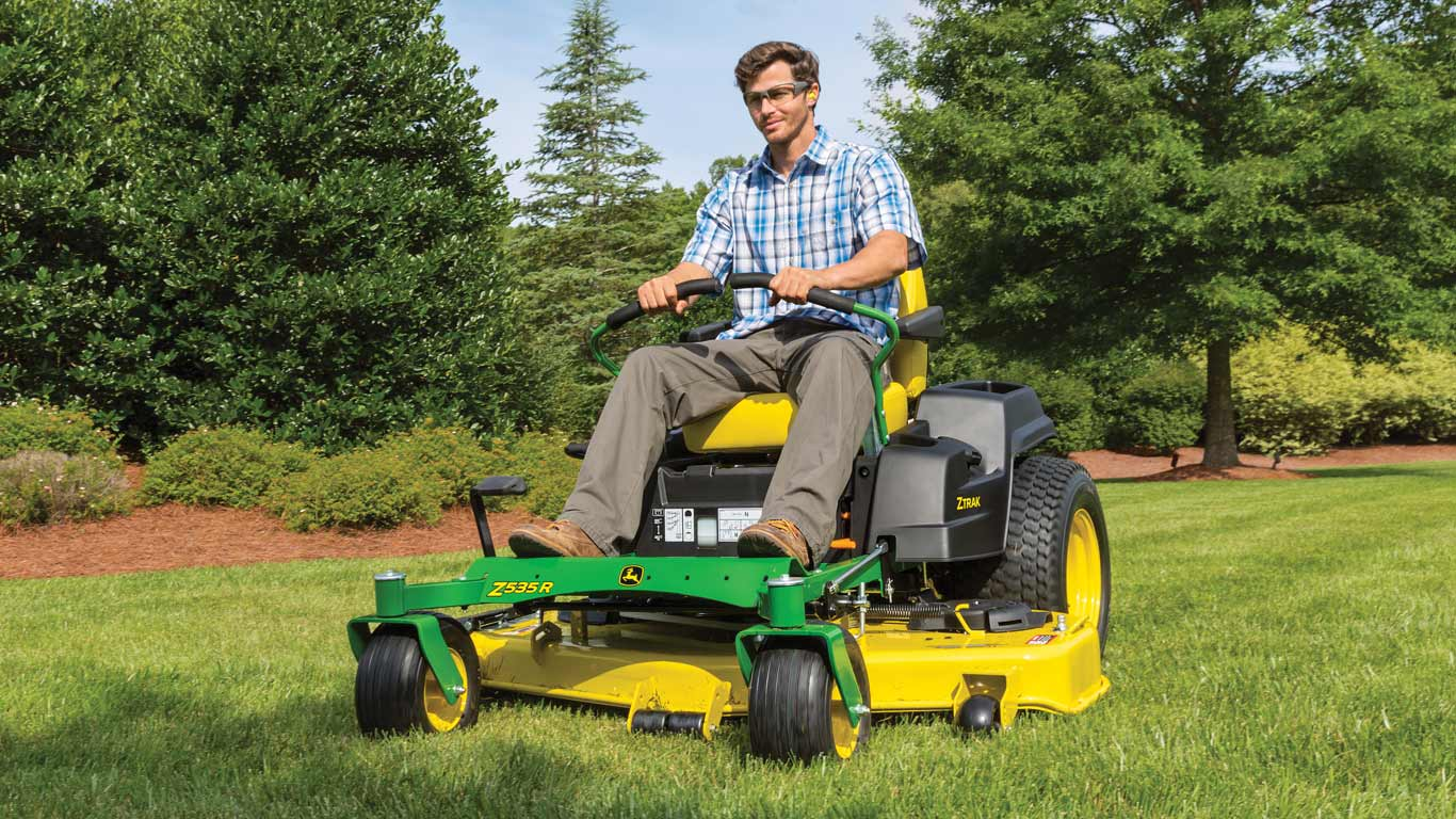 field image of man on a Z500-Series ztrak mower