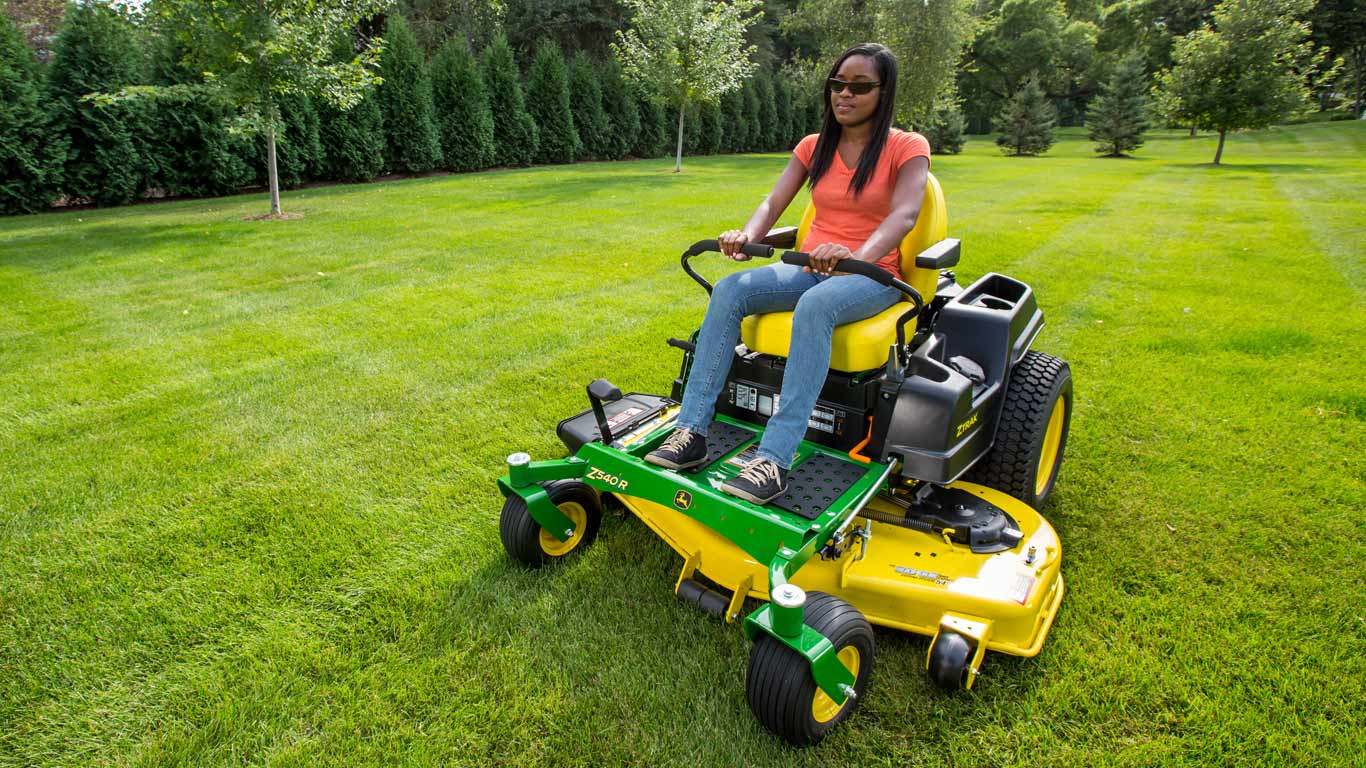 woman on a Z500 ZTrak on large lawn
