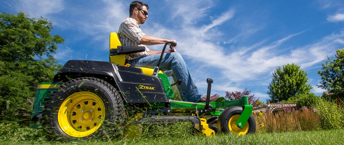 low angle view of a man on a z500 series ztrak zero turn mower