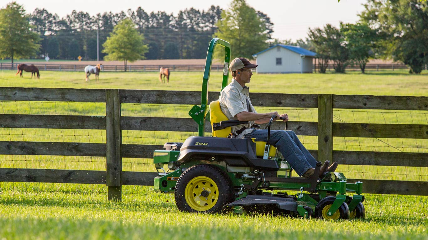 ztrak mowing by wooden fence