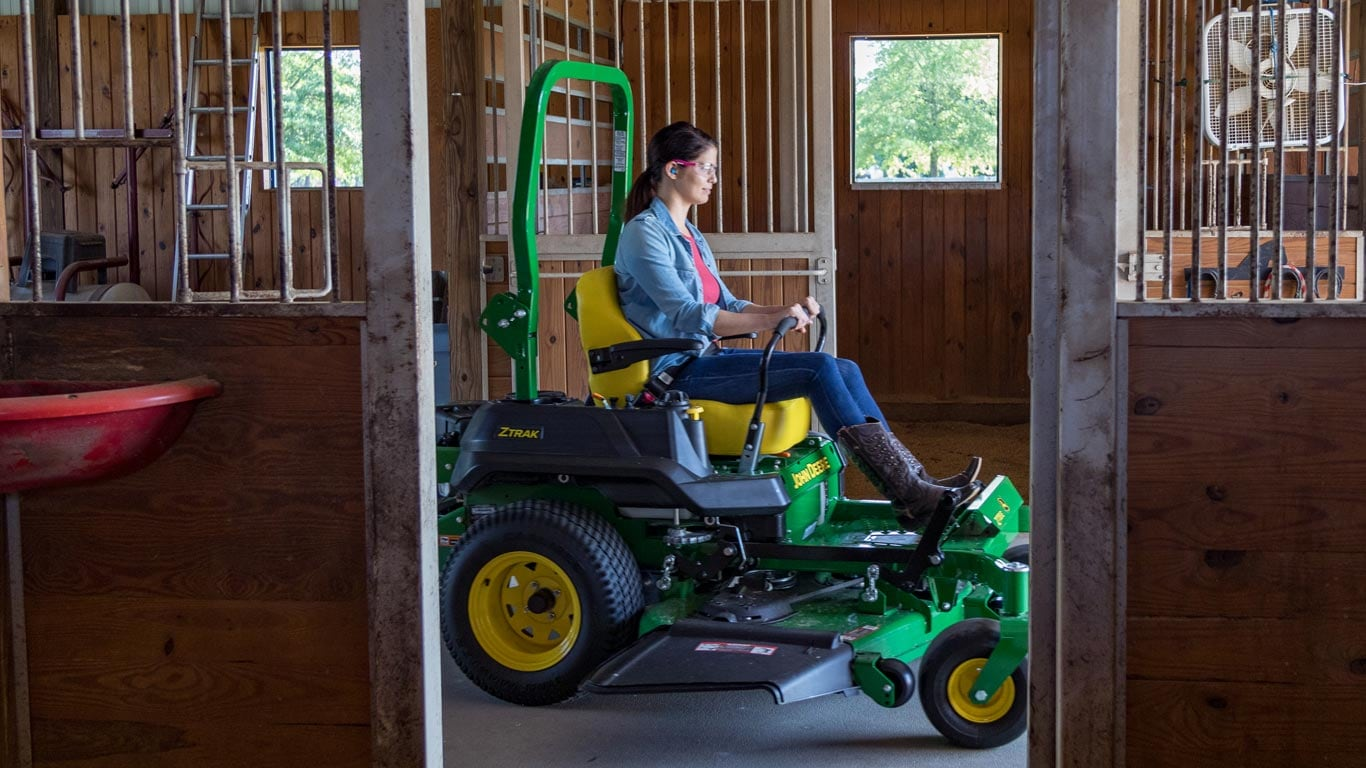 woman on z700 in a horse barn