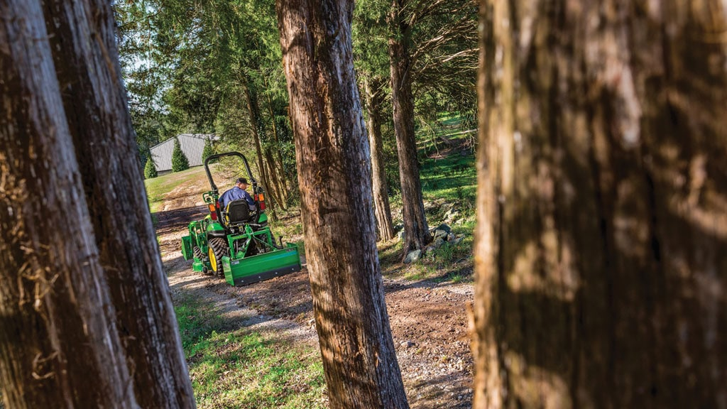 2025r tractor going through woods