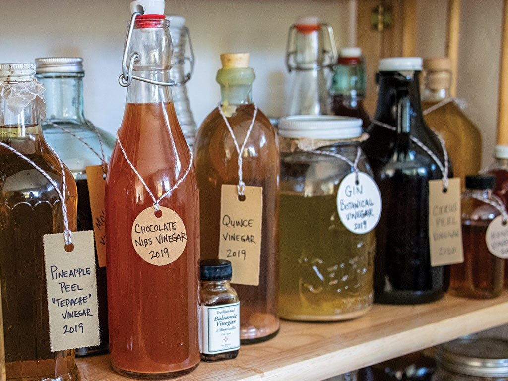 Dozens of vinegars bottles on the shelf