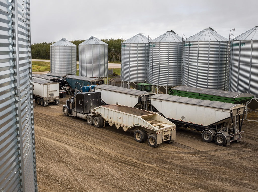binyard photo with trucks and multiple bins