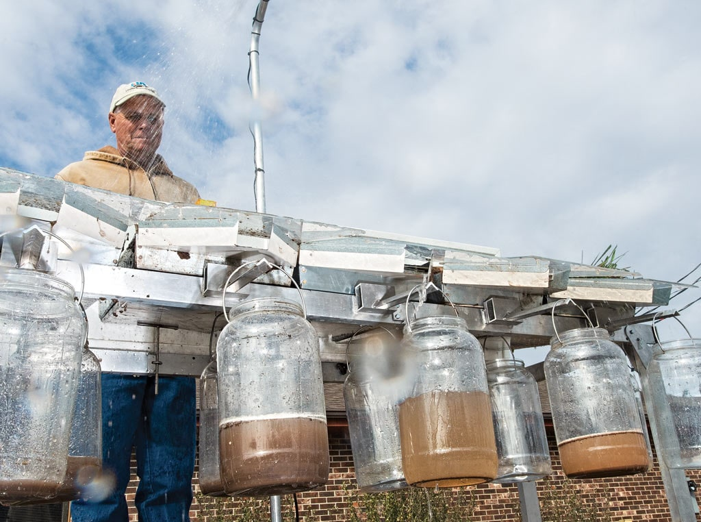 rainfall collector testing with jugs
