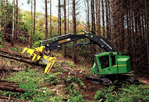 John Deere Feller Buncher with FR24B Felling Head chopping down a tree at a job site