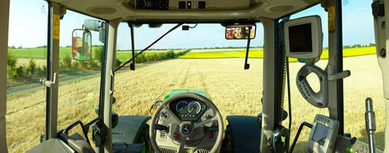 Tractor cab overlooking a field