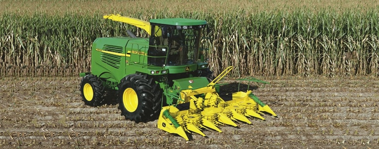 Harvester in corn field