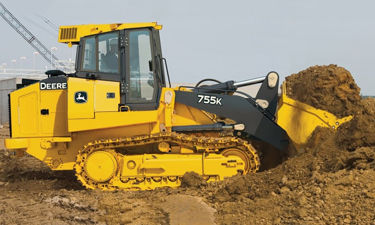 Crawler loader hauling dirt at a job site