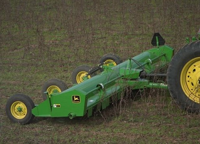 Closeup of the 115 Drawn Flail Shredder working in a field
