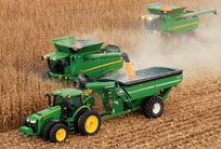 Overhead view of two John Deere combines harvesting corn in a field
