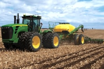 John Deere tractor using the 2510S Strip-Till Medium Residue Applicator in a field